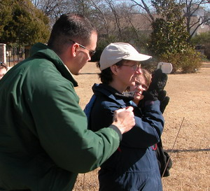 State Forester Matt Grubisich assists with the use of a Suunto clinometer at a volunteer traniing session
